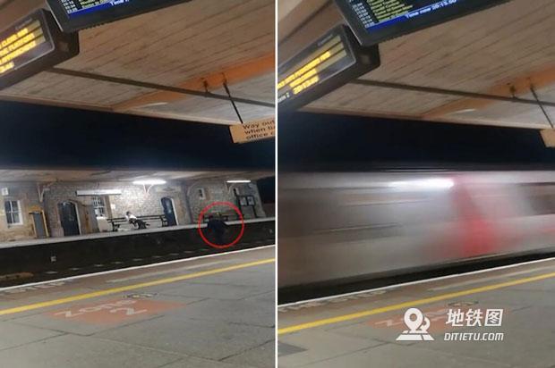 英国一醉酒男子跳到铁轨上捡包 与火车擦身而过